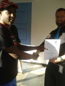 Dion Goredema receives certificate at District Chess Trials.